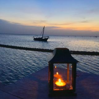 Lantern candle boat sea dusk